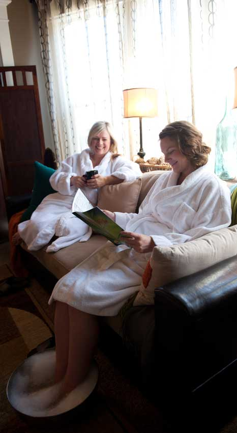 happy massage clients in robes